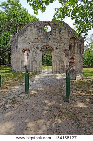 Tabby wall ruins of the Chapel of Ease from Saint Helenas Episcopal Church on Saint Helena Island in Beaufort County South Carolna vertical