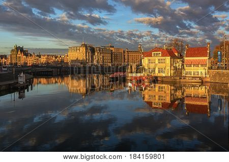 Amsterdam Netherlands - October 30 2016: The side of the historic waterfront property located on Stationsplein in Amsterdam