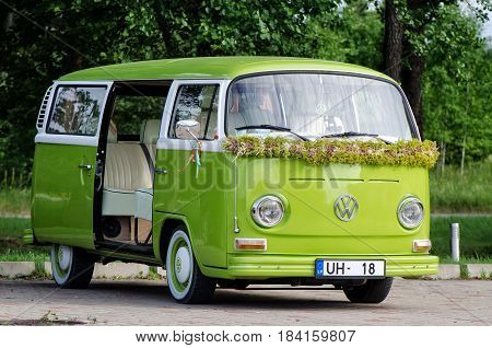 JURMALA, LATVIA - JULY 5 2013: Green old VW bus decorated for celebration.