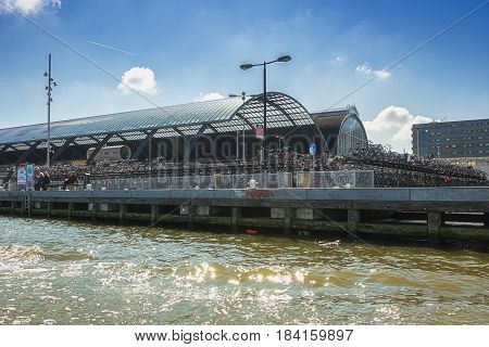 Amsterdam Netherlands - September 9 2015: The bicycle storage behind Amsterdam Central Station along the River IJ.