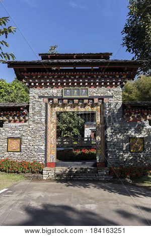 Chinese Temple gate and stone wall tourist point zen style Chiang Mai Thailand