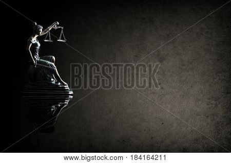 Lady Justice on grunge background and space for text