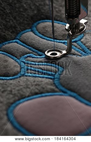embroidery and application with embroidery machine - progress satin stitch in portrait orientation