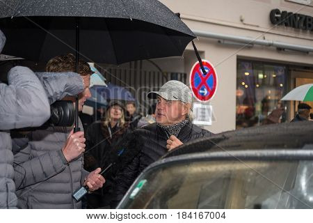 Neuoetting,Germany-March 28,2017:German actor Uwe Ochsenknecht is interviewed for german tv after arriving at the Neuoetting Stage of the Arabella Classics Rally