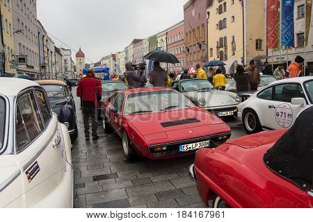 NeuoettingGermany-April 28,2017: Arriving cars at the Neuoetting stage of the Arabella Classics Rally park at townsquare at noon
