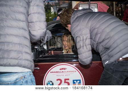 Neuoetting,Germany-April 28,2017: A participant at the Arabella Classics Rallye is interviewed for german tv at the rallye's Neuoetting stage