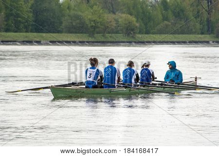 Neuoetting,Germany-April 29,2017: A sculls participating at the Inn-Beaver regatta from Neuoetting to Muehldorf rows towards the start line