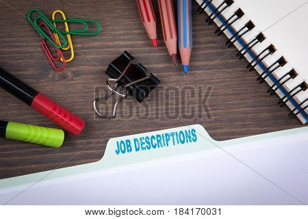 Job Descriptions. Folder Register on a dark wooden desk.