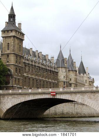 Castle Conciergerie And Seine River In Paris