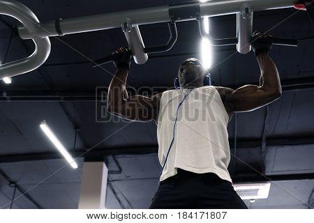 Black Man Doing Exercises Pull Ups