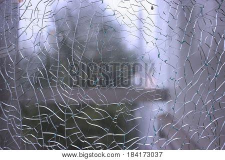 Shattered window. unfocused view thought the brocken window