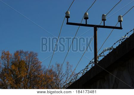 fenc ewith an electricity wire and a barbed wire