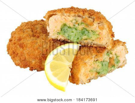 Breadcrumb covered salmon fish cakes with watercress sauce isolated on a white background