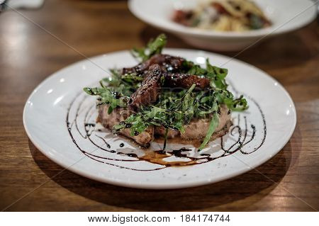 Grilled pork chop steak with apple sauce.