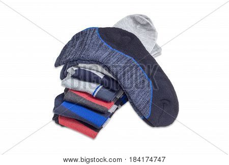 Pair of the gray-black men's sock on the stack of other different varicolored socks on a light background