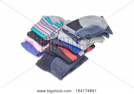 Two stacks of folded different varicolored men's and women's socks on a light background