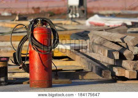 red fire extinguisher in a constraction background