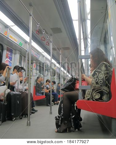 GUANGZHOU CHINA - NOVEMBER 15, 2016: Unidentified people commute by subway in Guangzhou downtown.
