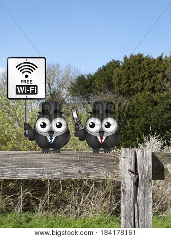 Comical free WIFI sign with businessmen accessing the internet via their mobile telephone perched on a countryside fence