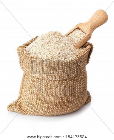 bran and wooden scoop in bag isolated on white background. Food supplement to improve digestion. Dietary fiber. Product for healthy nutrition and diet