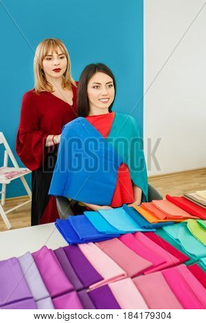 personal color analysis consultation for girl. Color type test. Image maker determines the colors that best suit an individual based on client natural colorings. Stylist working with young woman