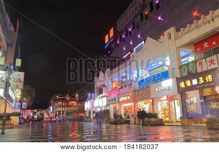 GUILIN CHINA - NOVEMBER 15, 2016: Unidentified people visit Zhengyang shopping street. Zhengyang street is a main shopping pedestrian street.