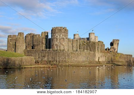 Caerphilly Castle reflected in its moat, Wales