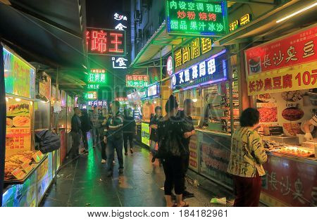 GUILIN CHINA - NOVEMBER 15, 2016: Unidentified people visit Shangshui Delicacy Street. Shangshui Delicacy Street is famous for traditional Gulin food.