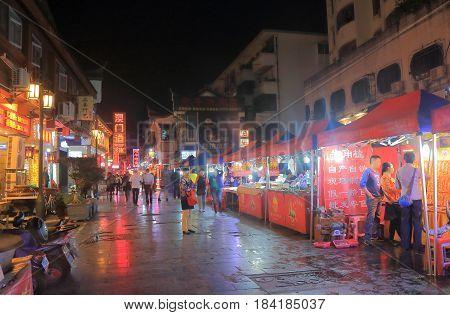 GUILIN CHINA - NOVEMBER 15, 2016: Unidentified people visit Xicheng shopping street night market. Xicheng street is a main shopping pedestrian street.