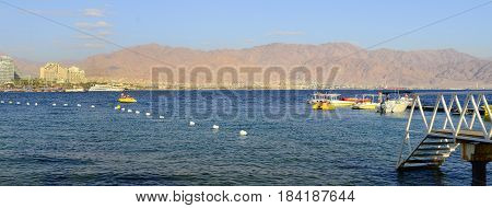 EILAT, ISRAEL-MAY 11, 2011: View on central public beach of Eilat - the southernmost port and famous resort and recreational city in Israel