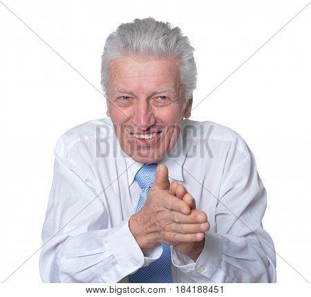Elderly businessman in a tie on a white background