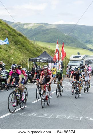 Col de PeyresourdeFrance- July 23 2014: Group of cyclists including Jose Serpa of Team Lampre Merida and Lars Bak of Team Lotto-Belisol climbing the road to Col de Peyresourde in Pyrenees Mountains during the stage 17 of Le Tour de France on 23 July 2014.