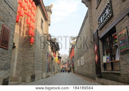 GUILIN CHINA - NOVEMBER 16, 2016: Unidentified people visit East West street. East West street features boutiques fashion galleries traditional teahouses and cafes in folk styles opened in 2018