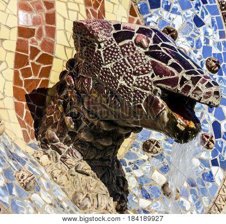 Barcelona, Spain - April 4, 2017: Dragon head Park Guell mosaic fontain, Gaudi