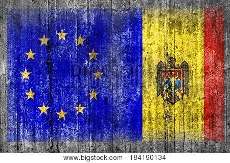EU and Moldova flag on concrete wall