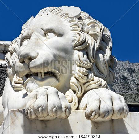 Marble sculpture of waking up lion in Vorontsov Palace in Alupka, Crimea, Russia.