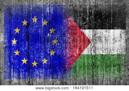 EU and Palestine flag on concrete wall
