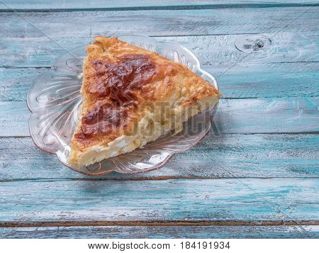 Traditional Bulgarian cheese pastry Banitsa on an wooden table