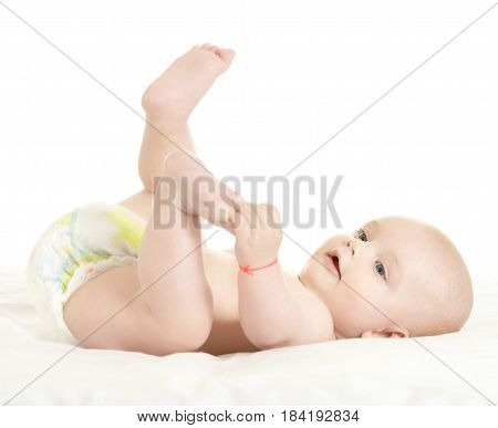 Adorable baby boy  in pampers on blanket on a white background