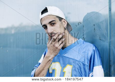 A Rap Singer Is Reflected In A Blue Mirror On The Outskirts