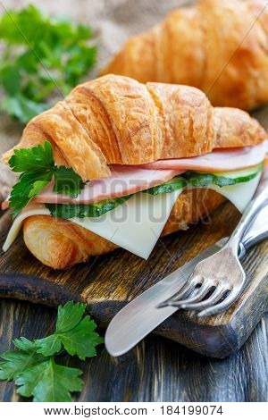 Delicious Croissant With Ham And Cheese.