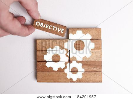 Business, Technology, Internet And Network Concept. Young Businessman Shows The Word: Objective