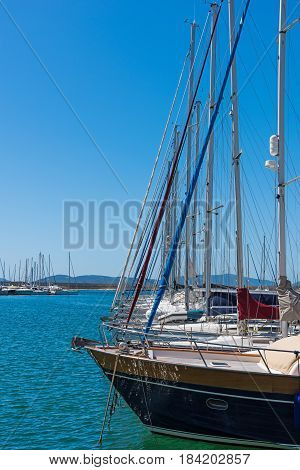 Boat masts in Alghero harbor in Sardinia