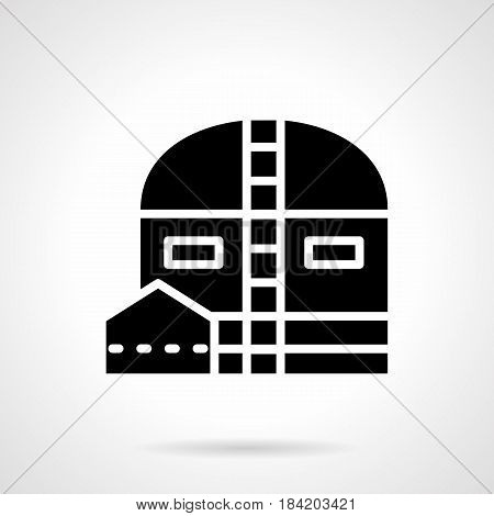 Abstract monochrome symbol of industrial depot. Storage hangar for factory, plant and other facility. Symbolic black glyph style vector icon.