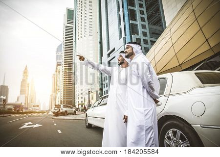 Arabic businessmen in Dubai with limousine car