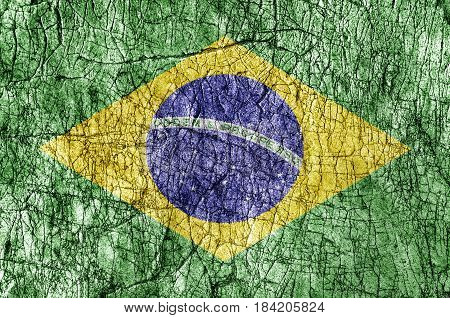 Grudge stone painted Brasil flag background close