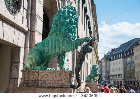 Munich, Germany - June 7, 2016: Bavarian lion statue at Munich Alte Residenz palace in Odeonplatz. Munich, Bavaria, Germany. Munich is the capital and largest city of the German state of Bavaria