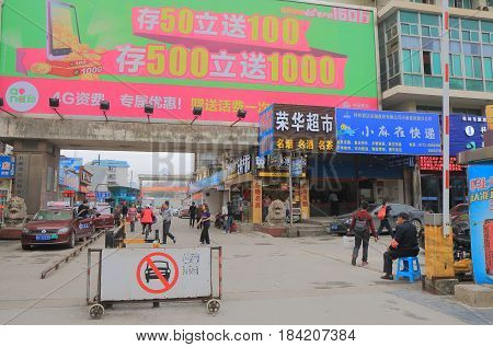 GUILIN CHINA - NOVEMBER 21, 2016: Unidentified people travel at Guilin long distance bus terminal.