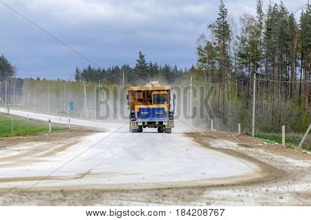 Large-yellow quarry dump trucks produce transportation of minerals