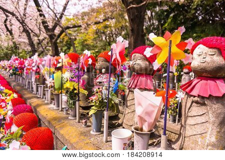 Jizo Japanese sculptures at Zojoji Temple in spring time at Tokyo Japan